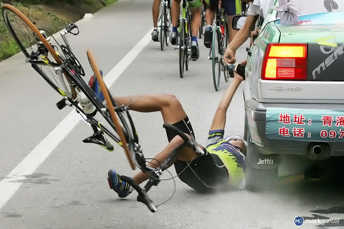 Taken at the 2006 Tour of Qinghai Lake Merida rider Kui Song came unstuck while collecting supplies back at his team car. Needless to say he didn't continue on, but he could consider himself lucky to only have a sore arm.