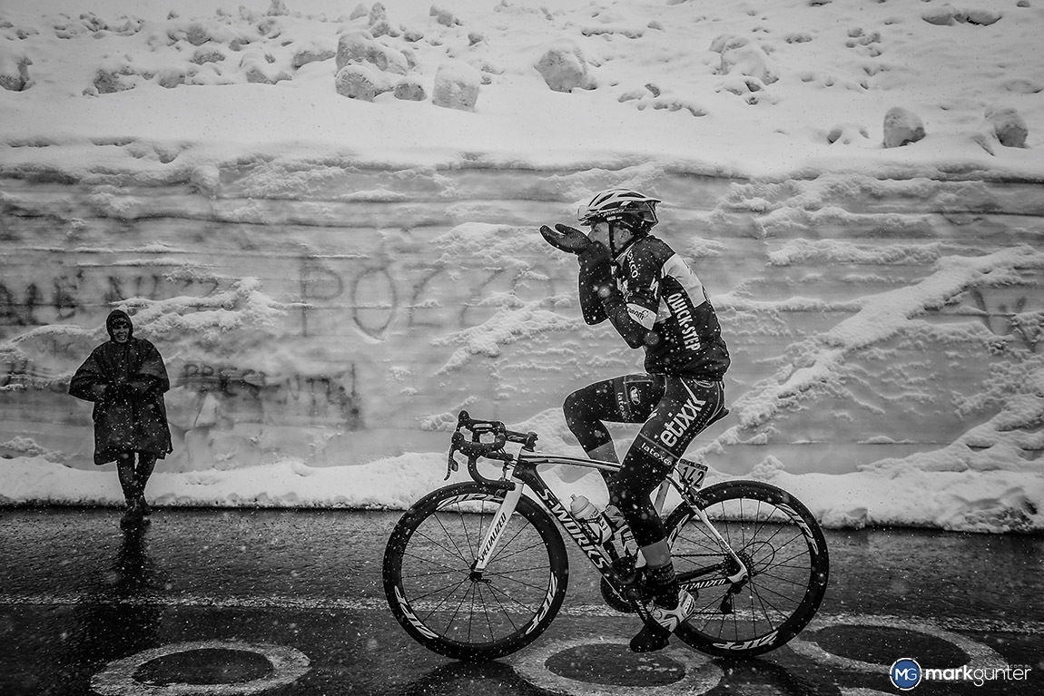 The Passo di Stelvio , Stage 16 of the 2014 Giro once again gave viewers on TV some great footage… Not sure if all the riders felt the same way!  Here Gianluca Brambilla adjusts his winter gloves as he reaches the top of the summit.