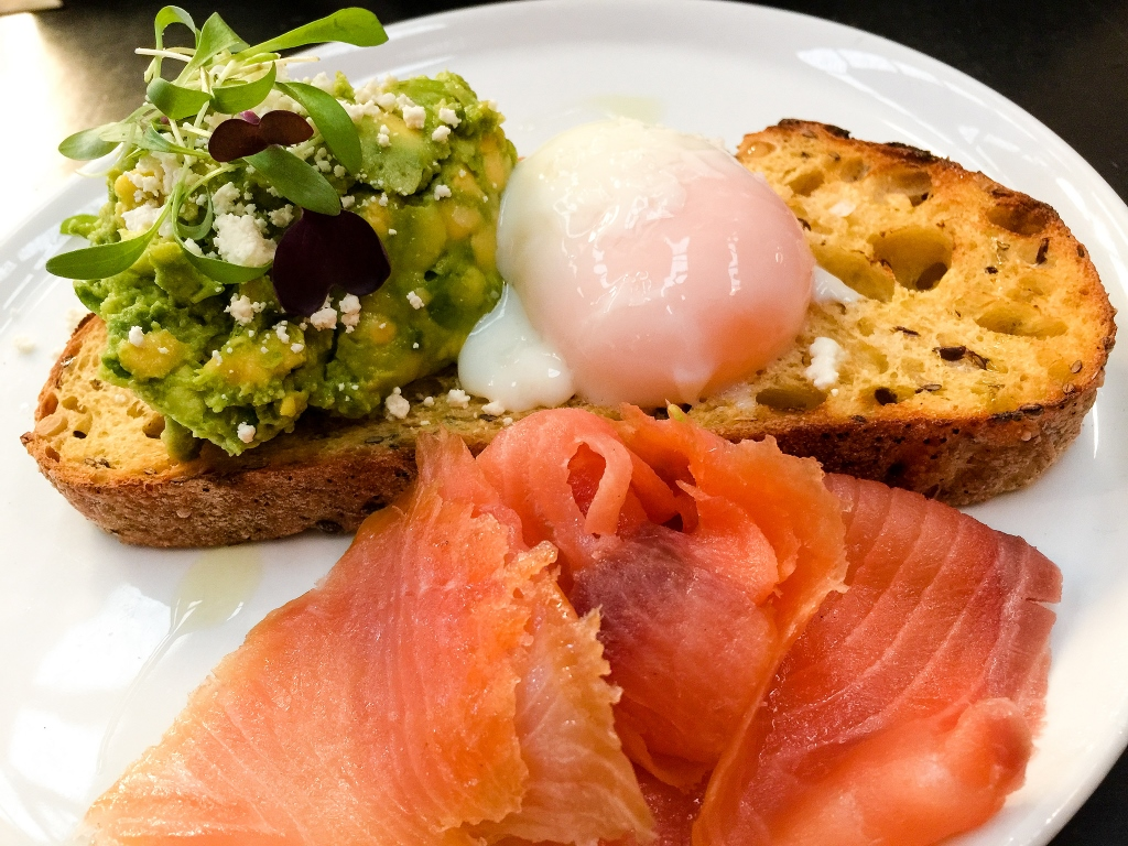 Healthy fats: avocado, poached egg and salmon.