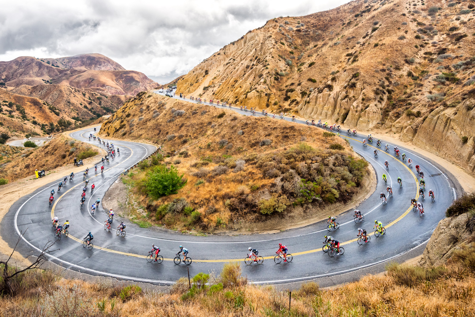 """Darrell Parks, United States. """"The Peloton navigates the sweeping turn of Grimes Canyon on Stage 5 of the 2015 AMGEN Tour of California."""" DSLR. @dparksphoto"""