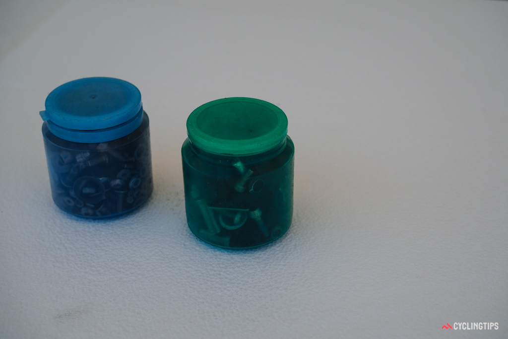 This Dimension Data mechanic stores small parts in used breath mint containers.