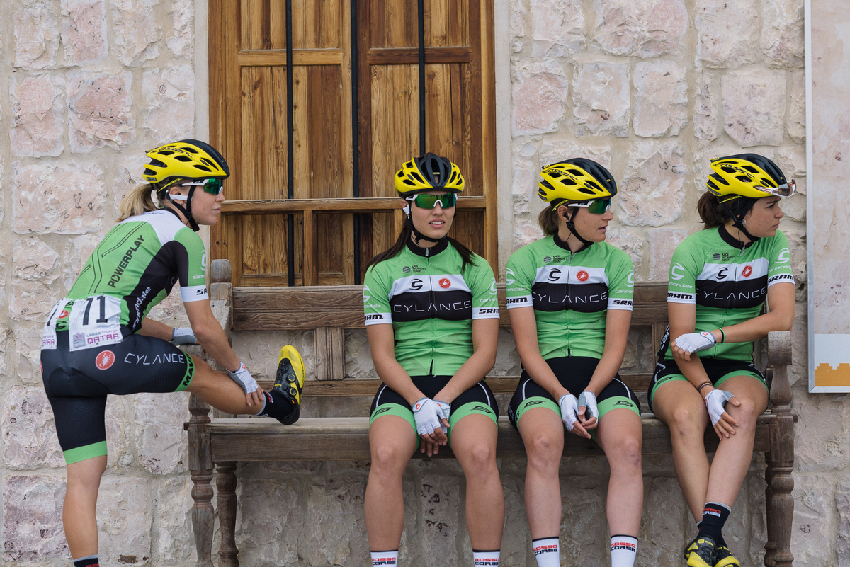 Cylance take shelter from a few spots of rain at the start at the Sheik Faisal Museum.