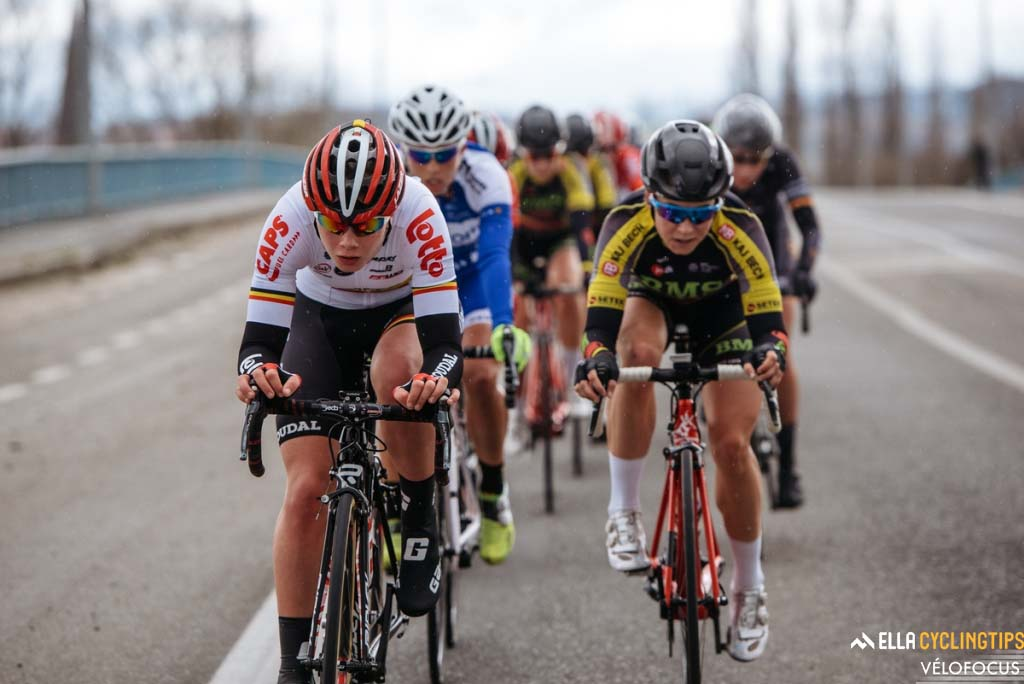 Lotte Kopecky (Lotto-Soudal) leads the front group of riders as rain drops come down in Flanders.
