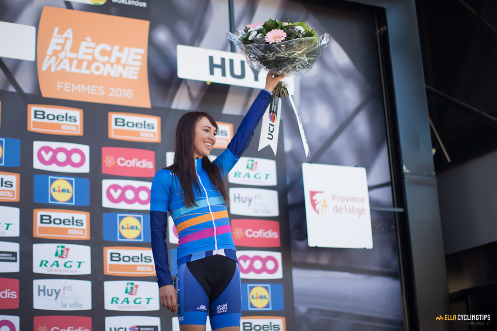 Kasia Niewiadoma (Rabo-Liv) on the 2016 Fleche Wallone podium to receive the young rider jersey.
