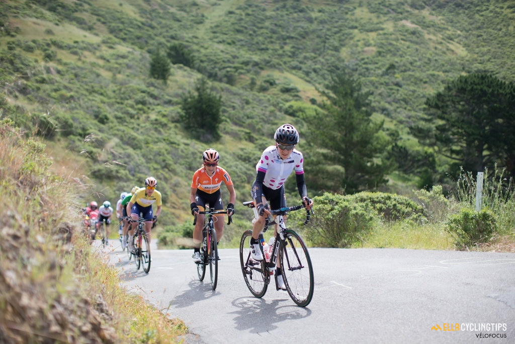 Mara Abbott (Wiggle-High5), in the climber's jersey, leads the peloton up the second QOM