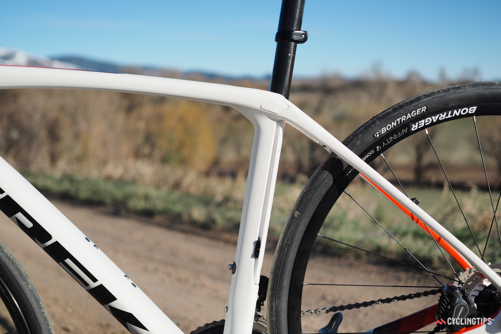 Splitting the seat tube into two sections allows the bigger, forward half to serve solely as a structural member for the frame. The thinner, rear half is moulded as one piece with the integrated seatmast and essentially acts as a leaf spring to smooth out the ride.