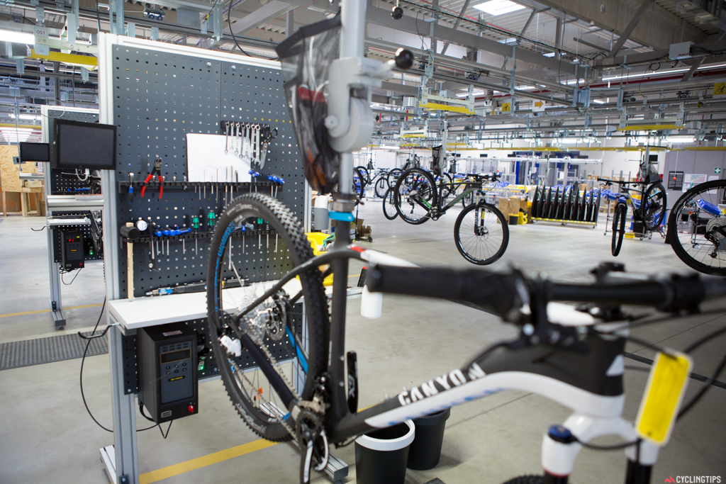 Canyon's new assembly facility where bikes travel between 18 stations (depending on the bike) and move on after approximately 60 seconds.
