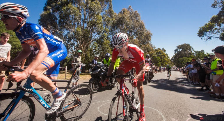 Former teammate Mark O'Brien (Avanti Racing team) leads Lapthorne up the Mt Buninyong climb in the final lap.