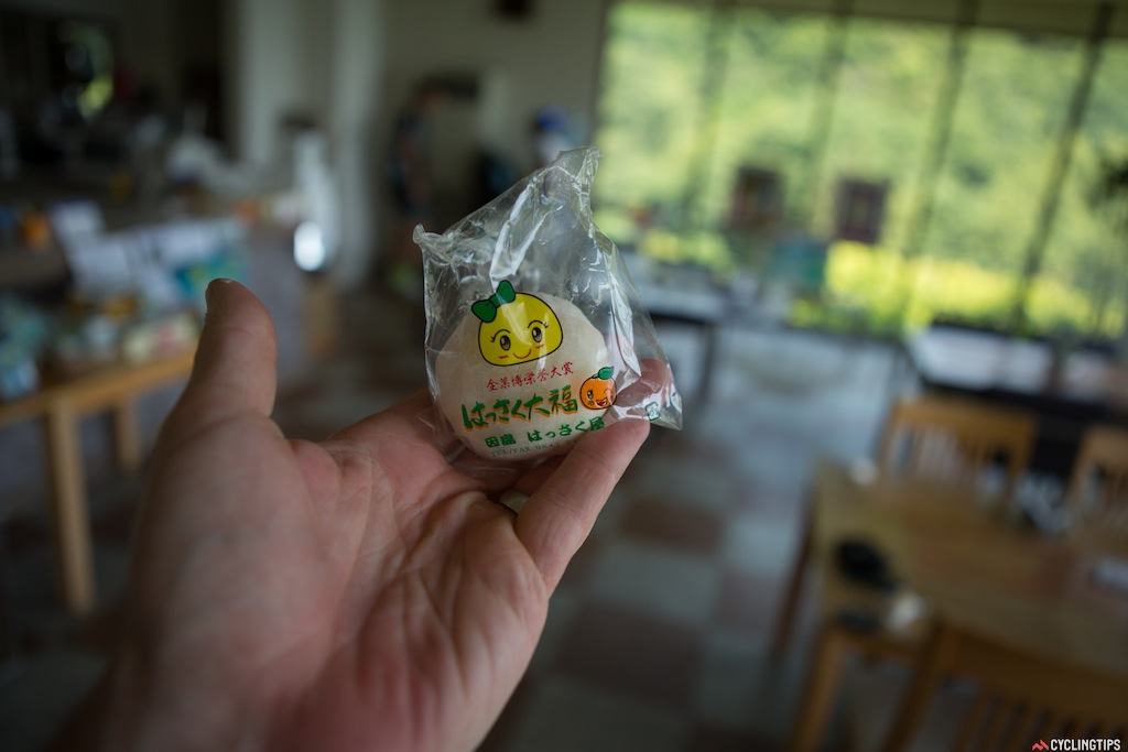 """Oranges are a big part of the agriculture in the area and this one cafe makes these incredible orange and strawberry """"Hassaku orange Daifuku"""". It's a sweet rice pastry wrapping around the fruit."""