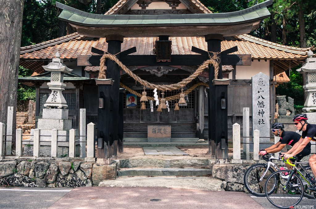 Riding past one of the many shrines in the area