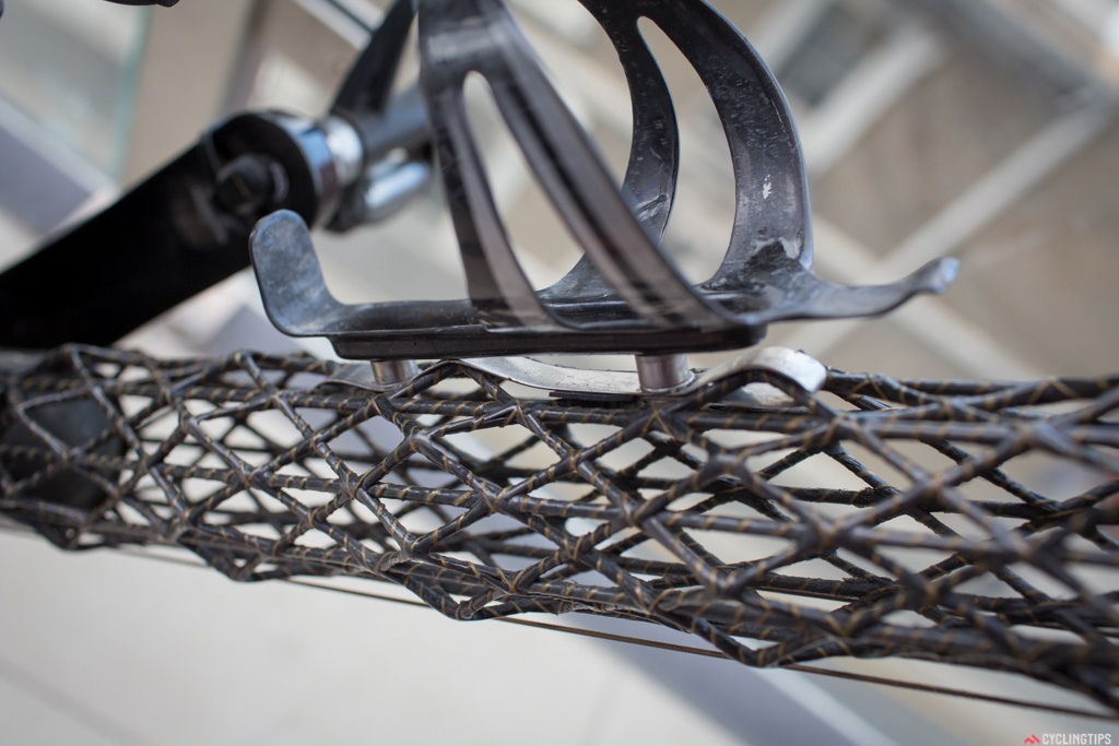 The bottle cages are attached to the frame by these braces shown here, but since the original ones broke these don't look nearly as nice as the original solution