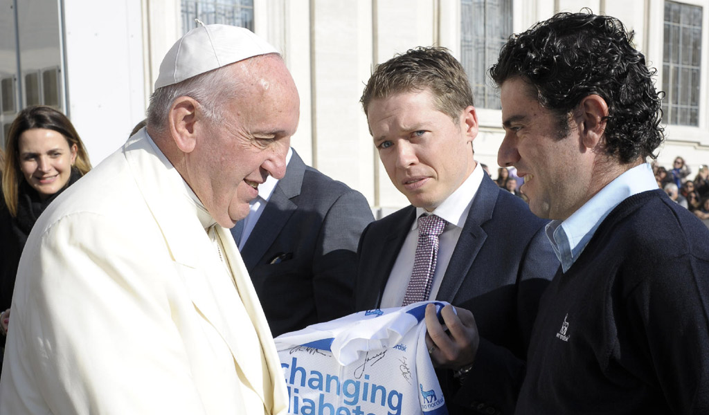 Phil Southerland and Team Novo Nordisk rider Javier Megias meet Pope Francis at the Vatican on Wednesday November 11, 2015