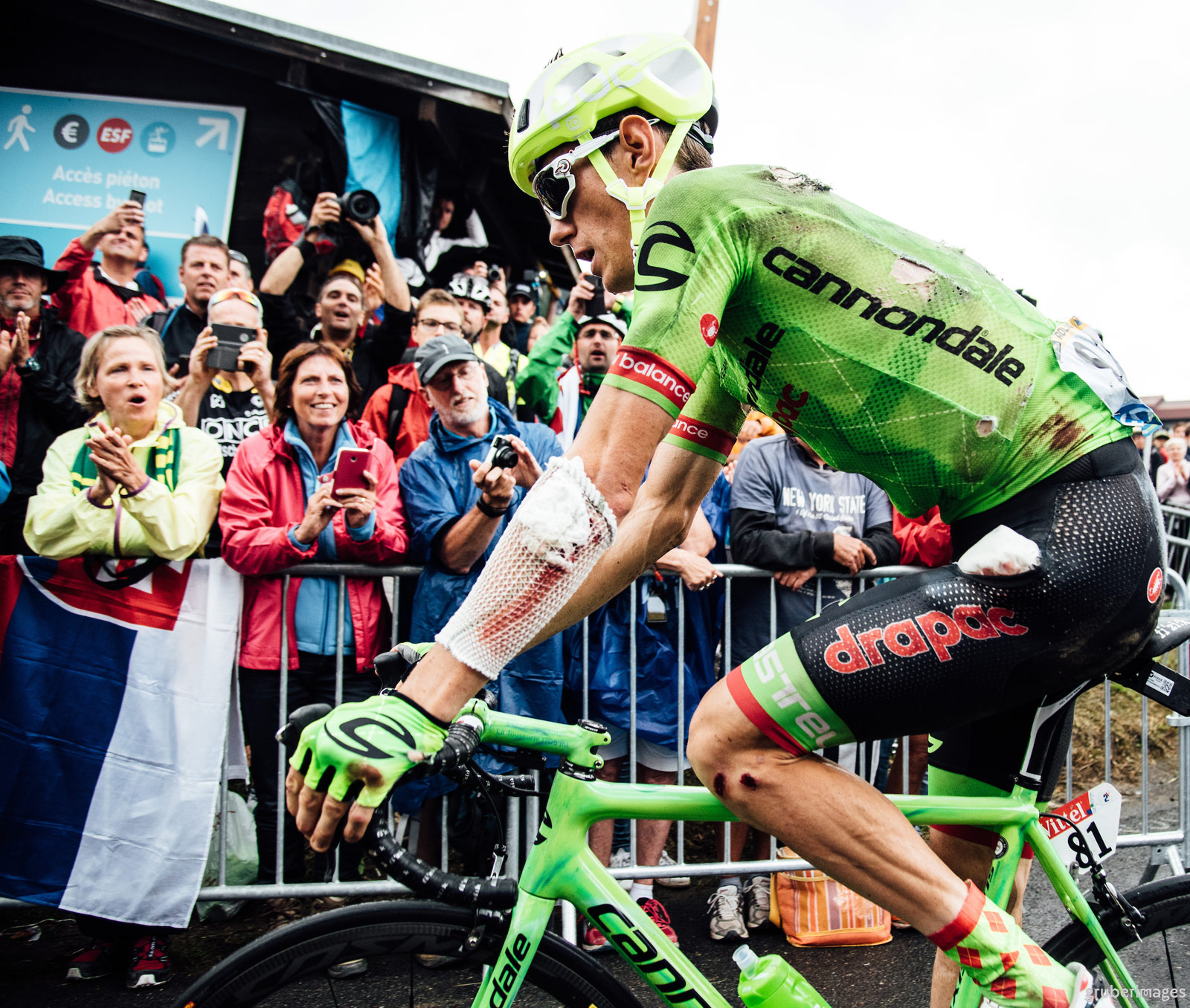 Battered and bruised, Pierre Rolland (Cannondale) crosses the line at the end of stage 19 of the 2016 Tour de France.