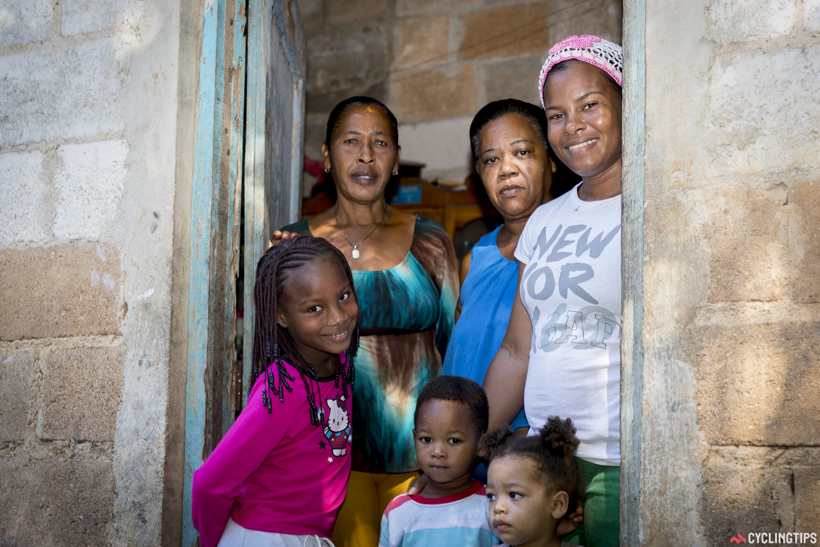 One of the three familes being helped by the house build. Three of the six pictured (mother, daughter and son) will live together with their father in the new dwelling, having had to share with her parents previously.