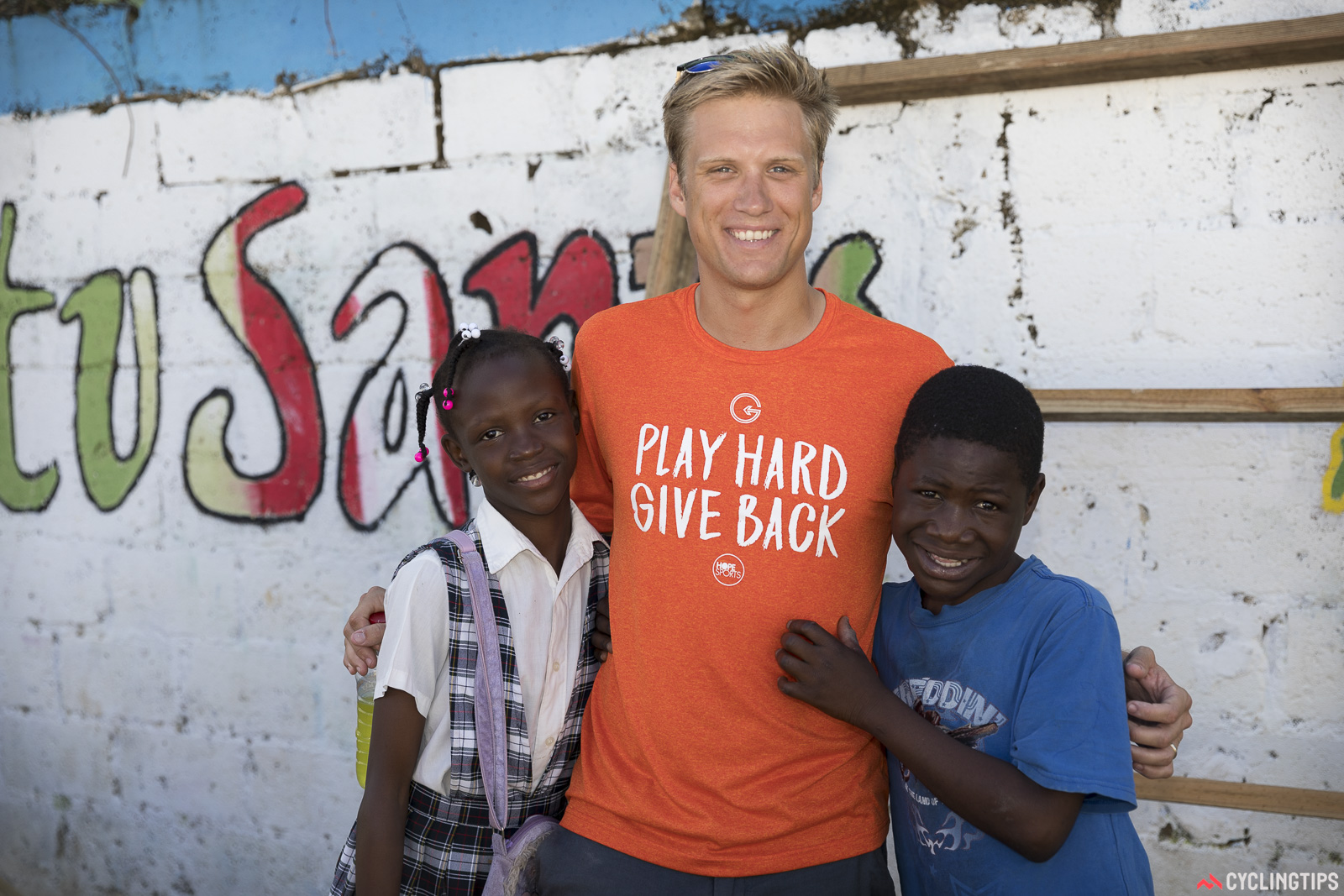 Hope Sports founder Guy East with two of the children from the village.