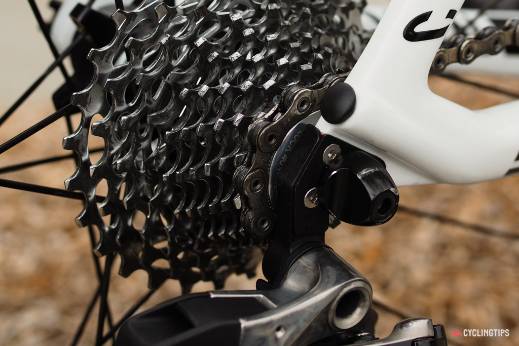 Canyon uses an admirably stiff two-piece 'sandwich' rear derailleur hanger on the Aeroad CF SLX. Don't fret over the dirty drivetrain, by the way. Kristoff had just returned from a training ride and the mechanics hadn't yet had a chance to wash the bike before we snatched it away for photos.