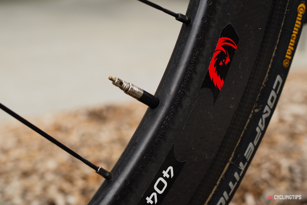 A simple wrap of electrical tape keeps the valve extender from rattling inside the Zipp carbon rim.