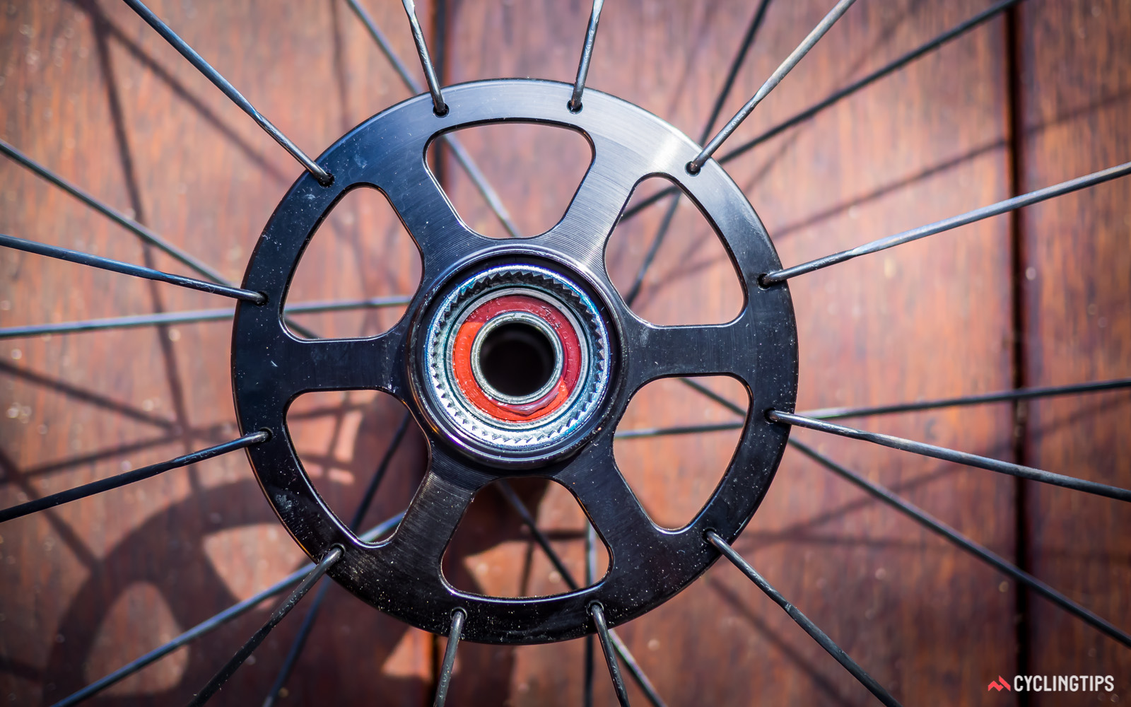 The radial lacing pattern used for the drive-side -f the rear wheel orients the spoke heads inwards.