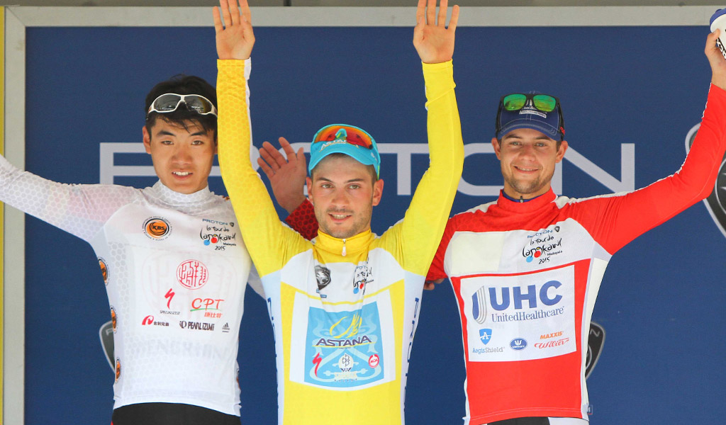 Andrea Guardini, leading Asian rider Guangtong Ma and Kiel Reijnen on the podium after stage 1 of the 2015 Tour de Langkawi