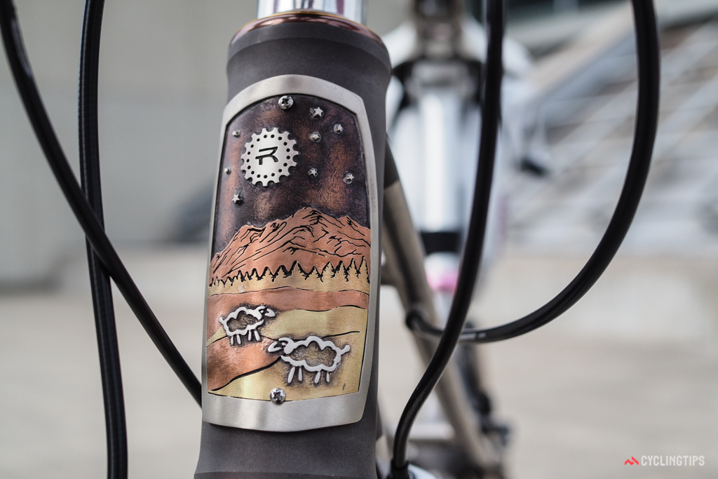 Black Sheep bikes feature custom head tube badges more often than not, typically made by jewelry artist Jen Green. This one was crafted for Debra Banks, whose Rivet Cycle Works logo is cleverly depicted as a moon casting light down on a flock of sheep against a backdrop of evergreen trees and mountains.