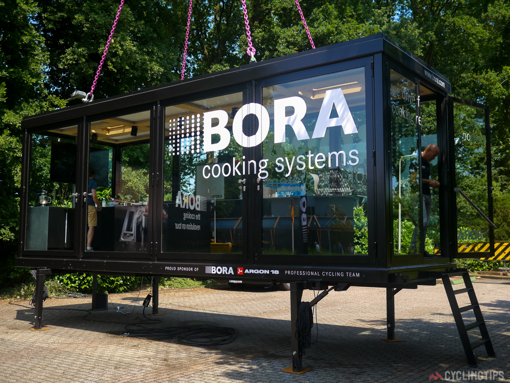 Bora's cooking truck being hoisted at the team presentation.