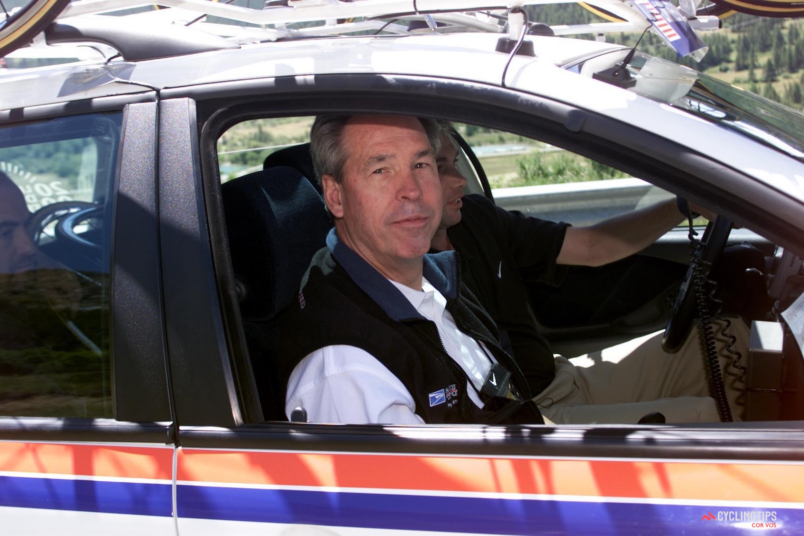 Thomas Weisel in the U.S. Postal Service team car at the 2000 Tour de France. Photo: Cor Vos.
