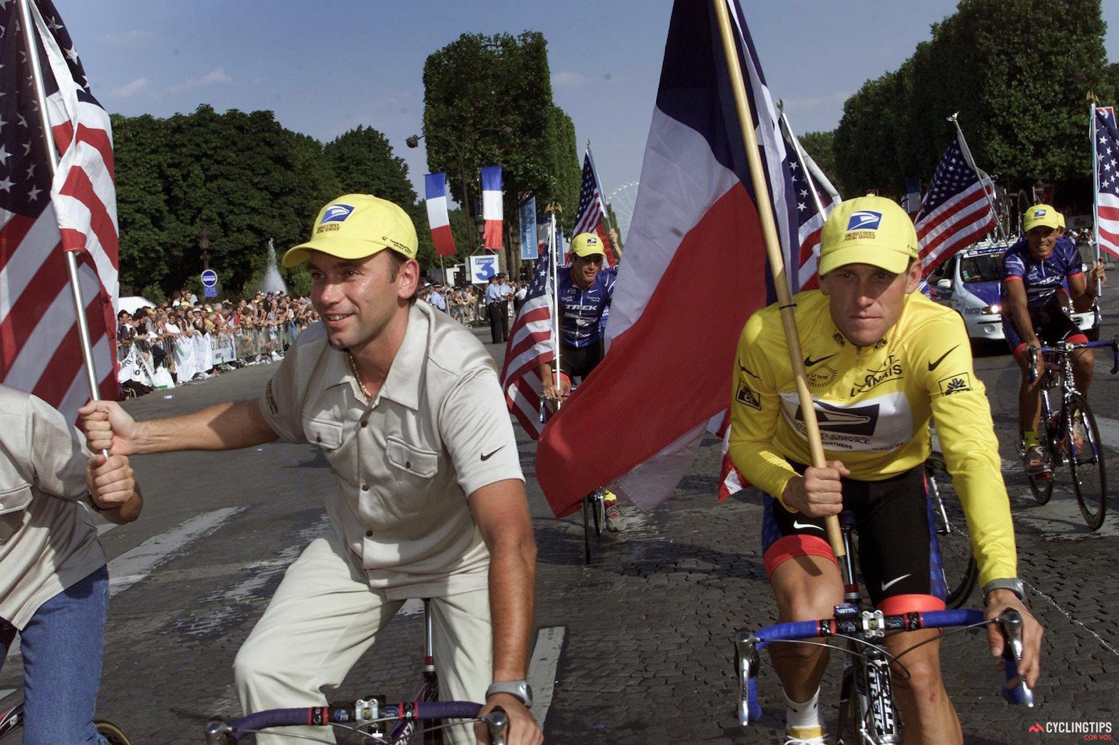 Johan Bruyneel (left) and Lance Armstrong on the Champs Elysees in Paris, at the conclusion of the 2001 Tour de France, Armstrong's third consecutive Tour victory. Photo: Cor Vos.