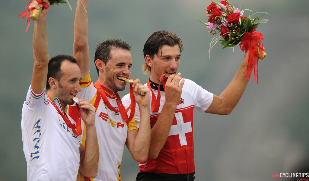 Davide Rebellin (Italy, l) finished behind Samuel Sanchez (Spain) and ahead of Fabian Cancellara (Switzerland), taking the silver medal in the 2008 Olympic road race. His samples were retested and he was subsequently disqualified. Alexandr Kolobnev of Russia moved up to the bronze medal position after Cancellara was promoted to second.