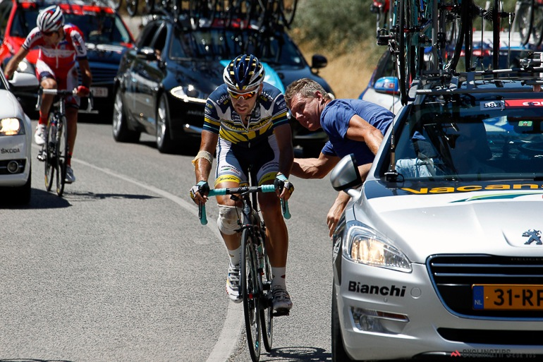 Riders get medical attention from their team cars and the in-race doctors after the carnage.