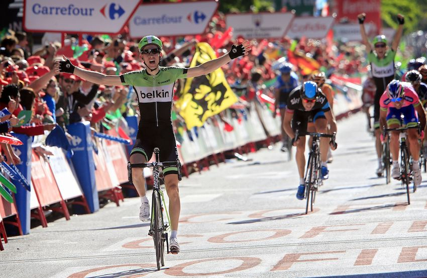 Bauke Mollema wins stage 17 of the 2013 Vuelta a Espana with David Tanner celebrating behind.