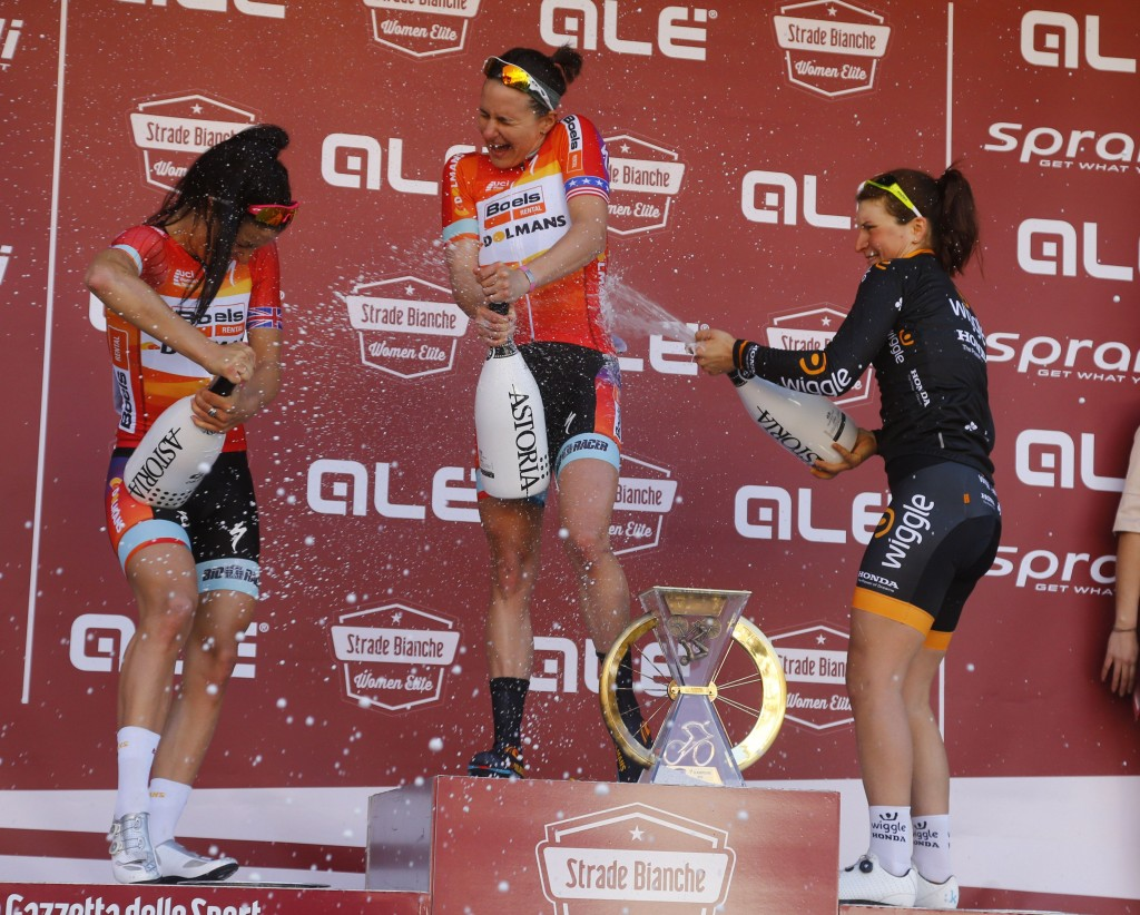 Lizzie Armitstead, Megan Guarnier and Elisa Longo Borghini celebrate with Astoria champagne on the podium of the 2015 Strade Bianche.