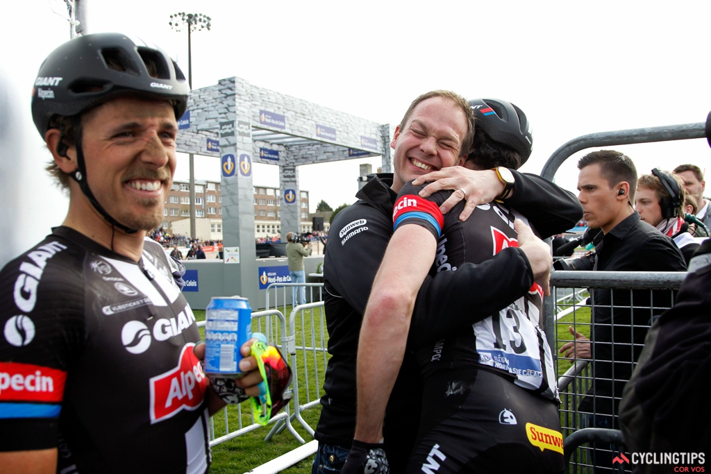 Giant-Alpecin team manager Iwan Spekenbrink embraces Roy Curvers after the latter helped John Degenkolb take his second Monument victory of the year.