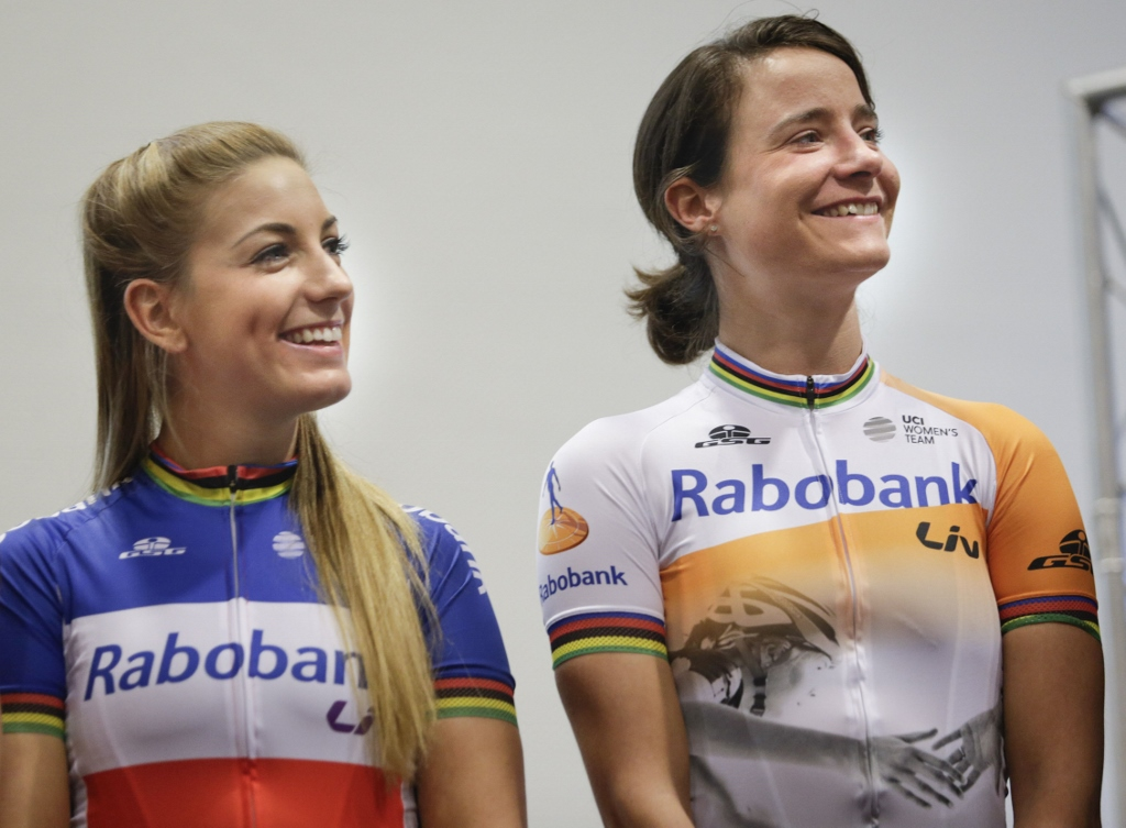 Pauline Ferrand-Prevot, wearing the French National Champion colors and world stripes, and Marianne Vos, also sporting the world champion stripes