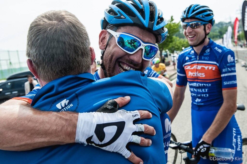 Hugs for Paddy Bevin after beating Caleb Ewan to win stage 4.