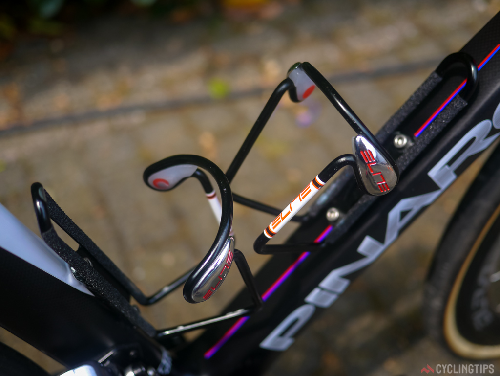 Alloy cages and grip tape prevent bottles for unexpectedly jumping from the cage once they hit the rough cobbles.