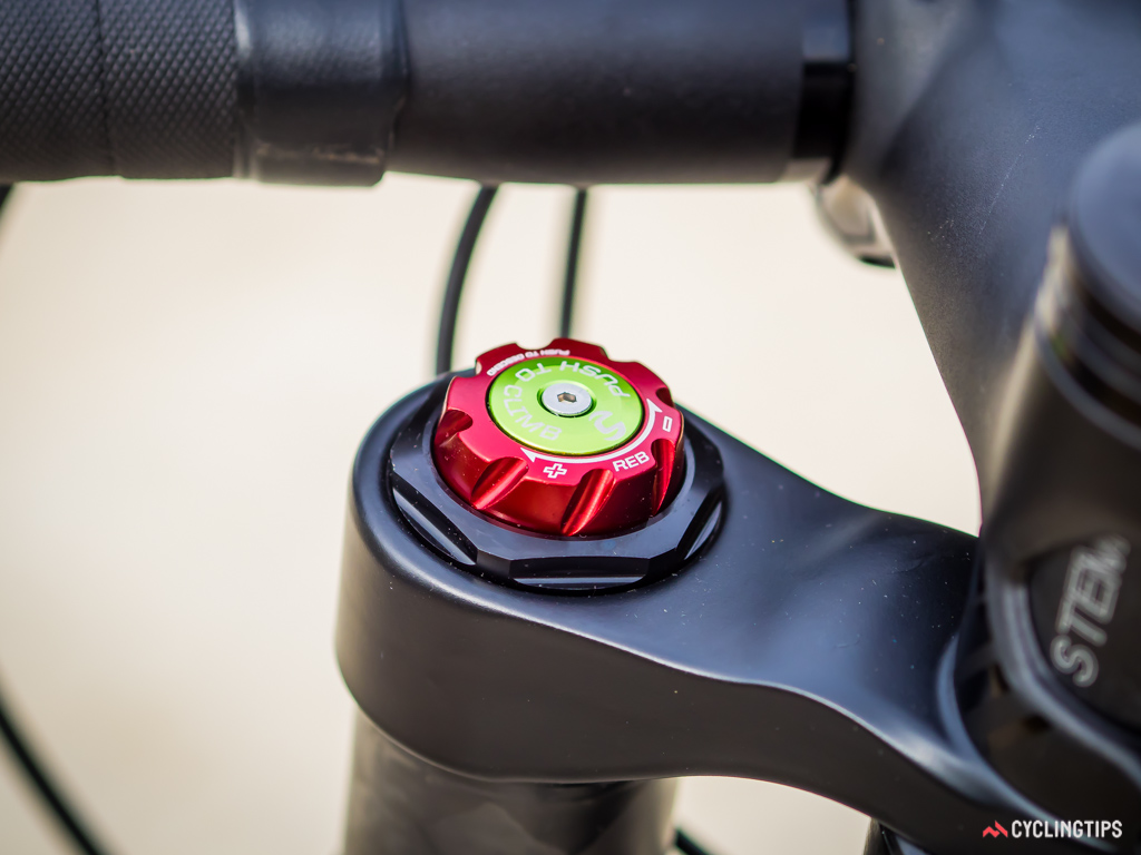 Wind the red dial to adjust the rebound of the fork, while the green button...