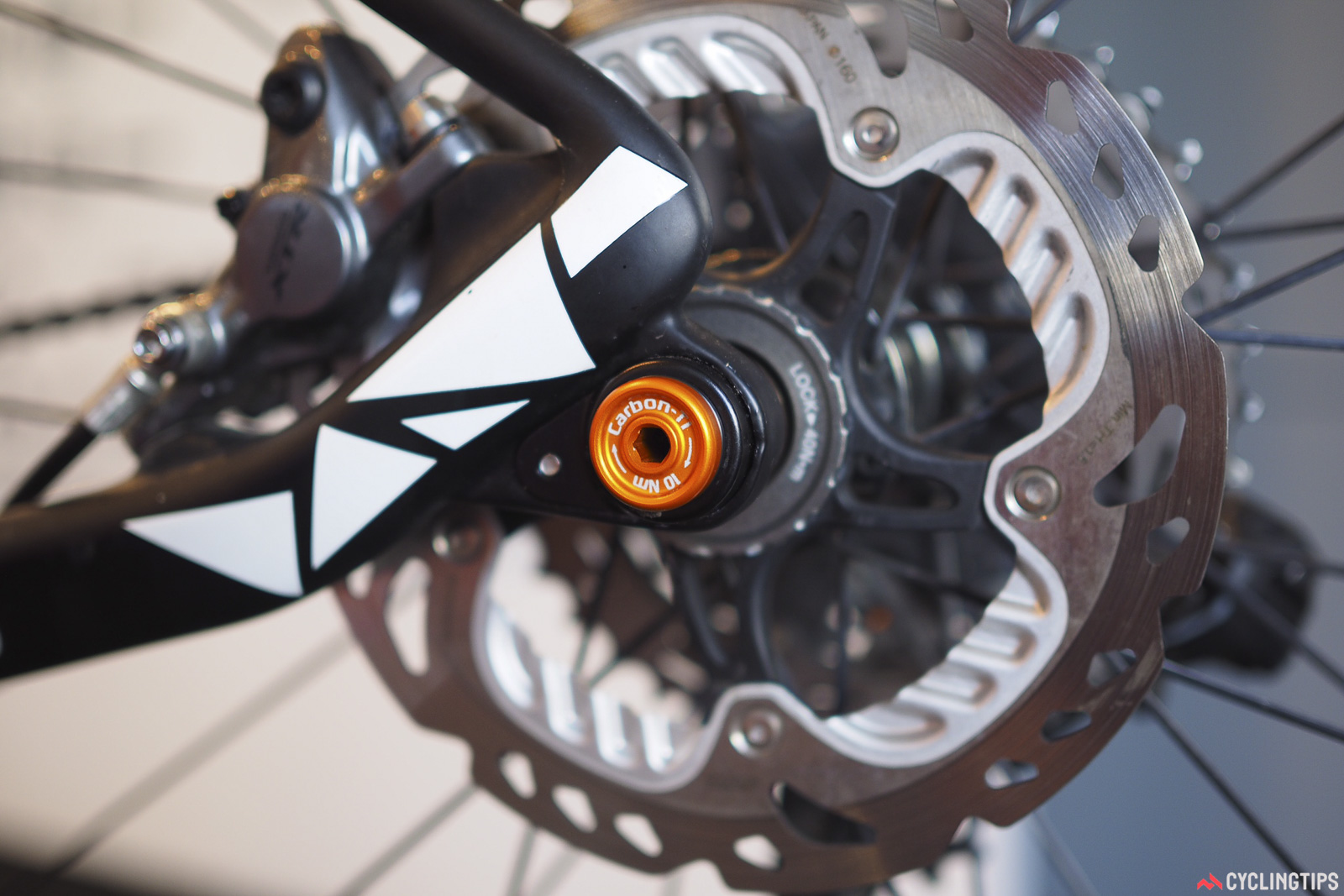 Looking to shed some weight from your thru-axle equipped disc road bike? Carbon Ti makes tooled axles claimed to save about 40g each - and yes, they're available in a broad range of colors and axle standards. Photo: James Huang.