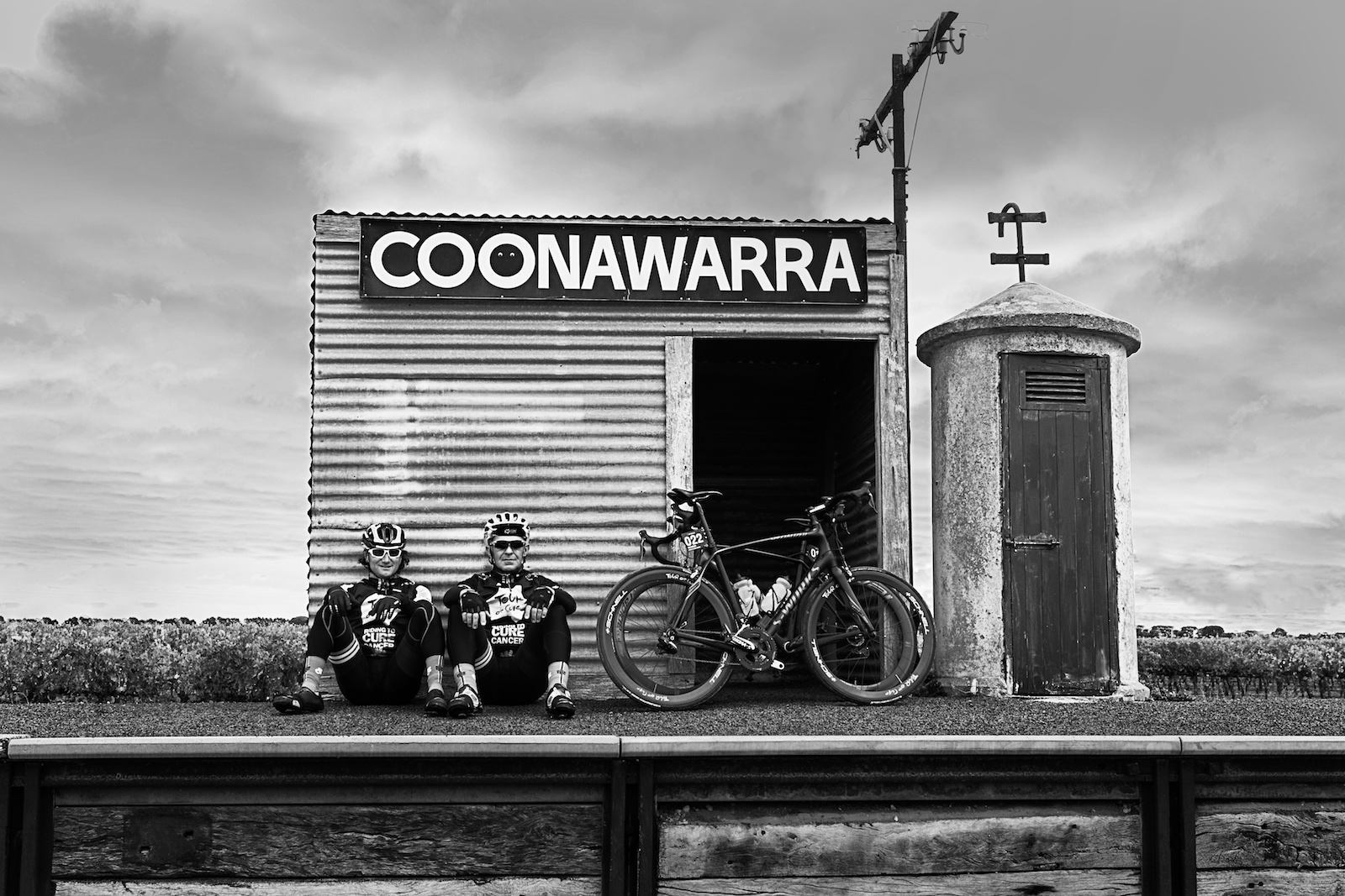 """Samantha Taylor, Australia. """"A couple of riders on the 2015 TourdeCure take a moment to rest on the old railway station in the Connawarra wine region of South Australia."""" DSLR."""