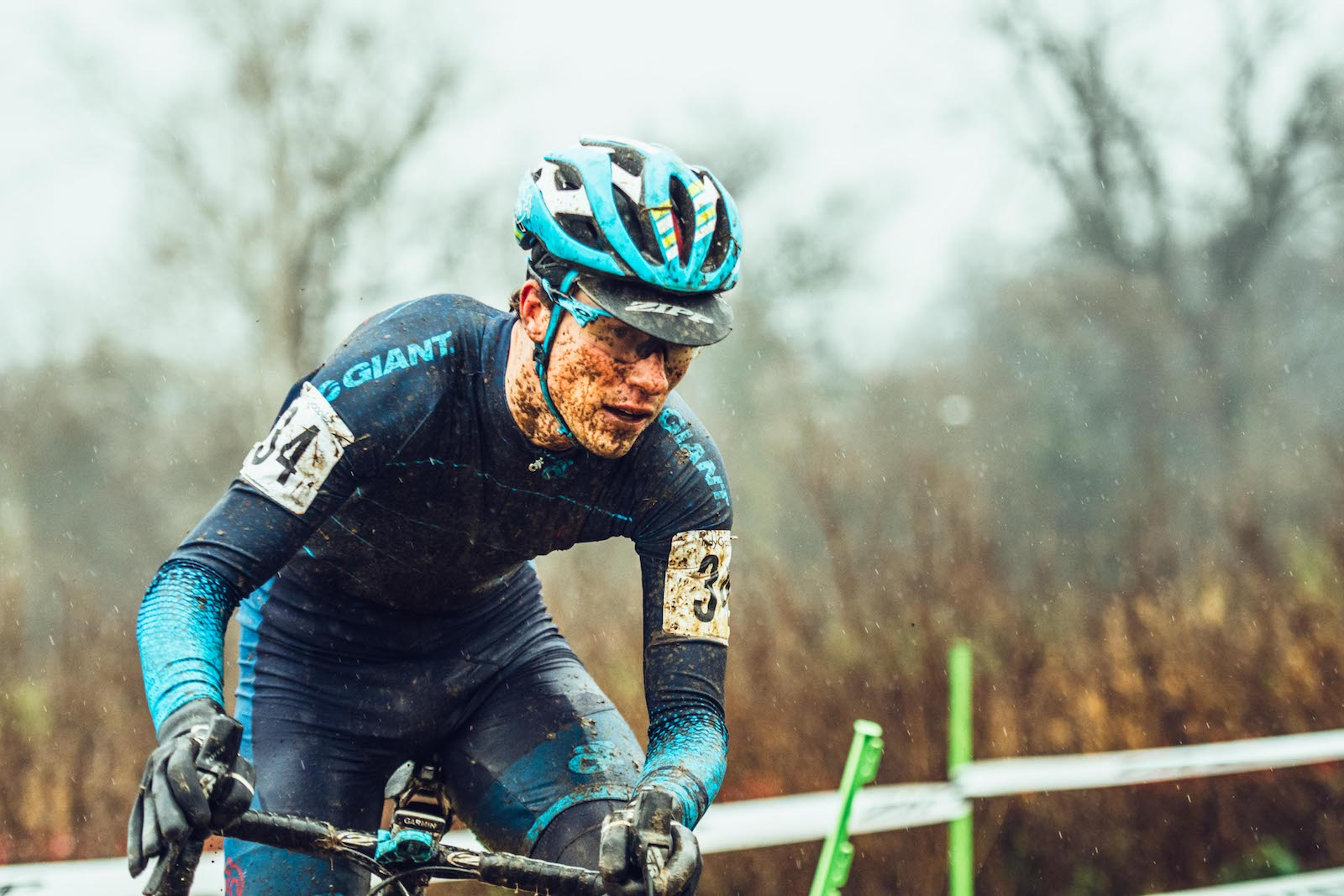 """Andrew Hoffman, United States. """"Team NeighborLink cyclocross rider, Josh Johnson, three laps into the UCI-C2 event at the Indy Cycloplex on Dec 4th. The event was the muddiest race of the season for Josh, and had temperatures right around 40 degrees. The fun of a wet, muddy cross races diminishes when it's on the brink of freezing. Every rider that day looked shattered at the end of the race due to the high intensity of professional cyclocross combined with miserable conditions."""" DSLR. @andrewdewey"""