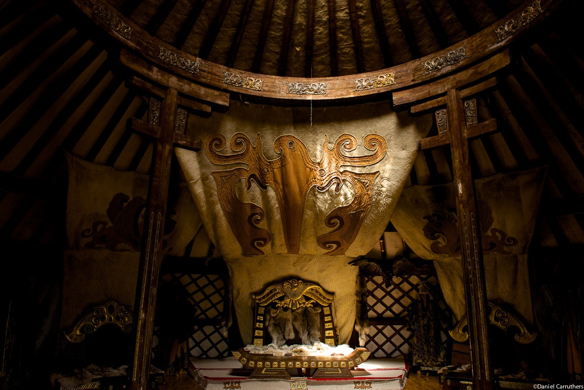 Inside the main Ger at the 13th Century Village - the throne covered in furs.