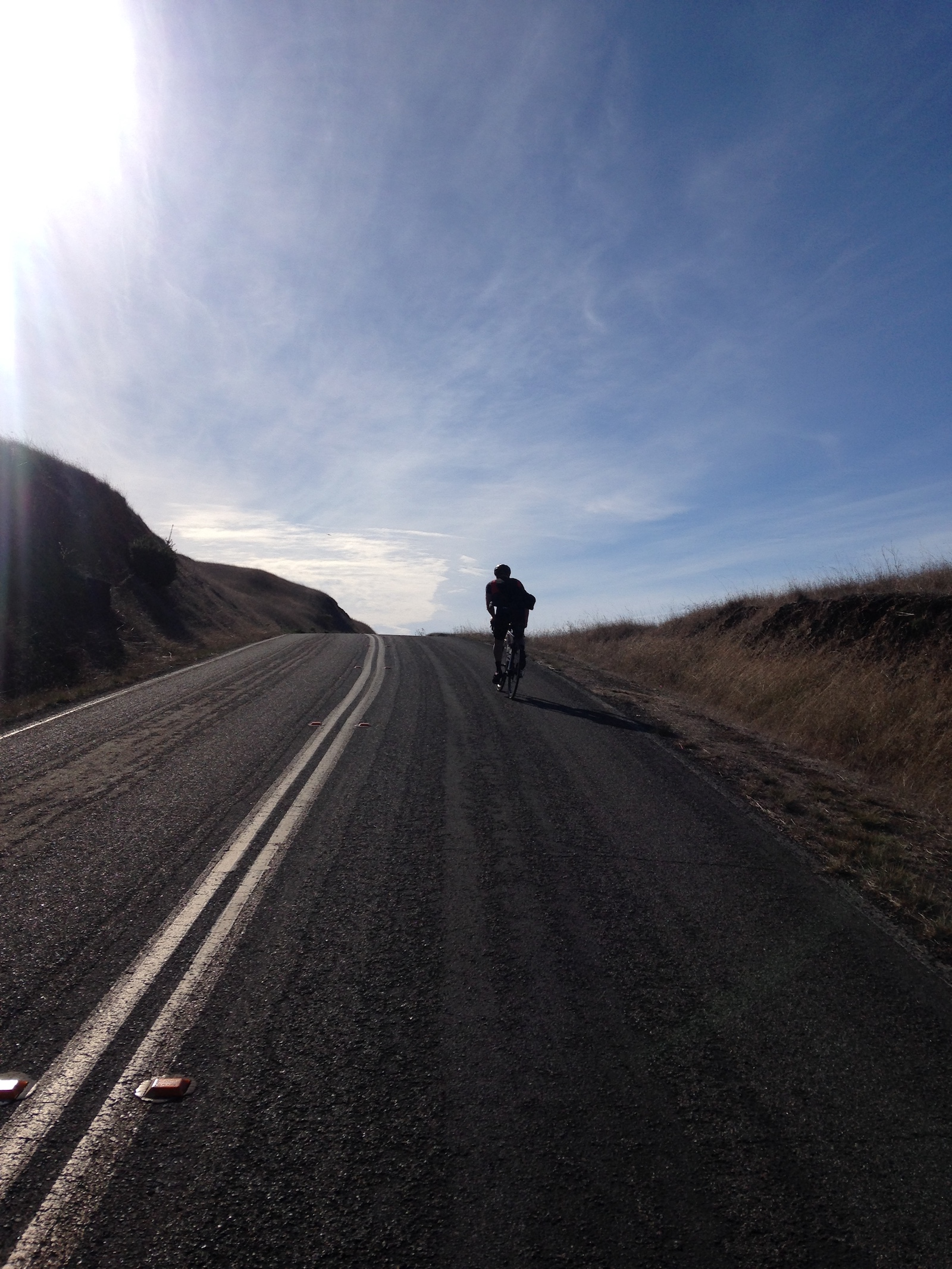 """Dana Williams, United States. """"""""Dancing"""" - After taking a quick pits stop, I rode to catch up to my friend Kyle Ulinder just as he crested the first of seven small punchy climbs on a popular ridge in Marin County (California) called Seven Sisters. I pulled out my iPhone from my back pocket and snapped this photo."""" Smartphone / Action Cam. @danawilliams26"""