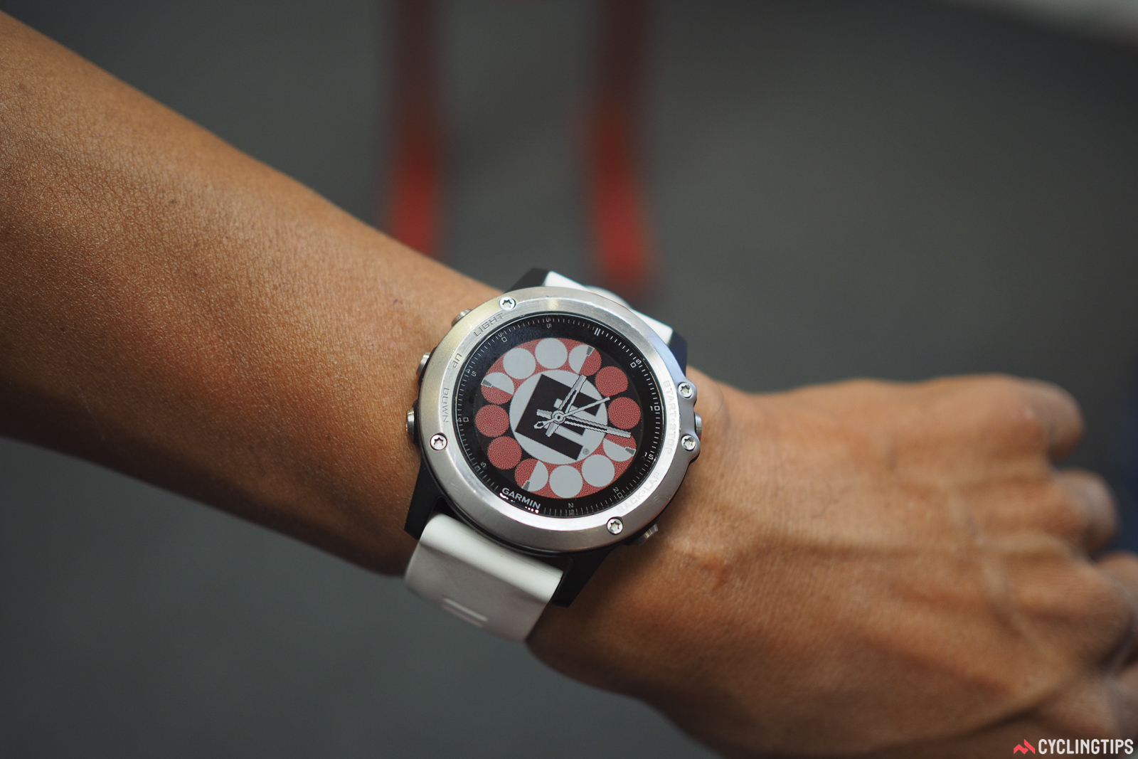 That's no decal, folks. Chuck Panaccione of  is so committed to his company that he had the logo set as the backdrop on his Garmin watch. Photo: James Huang.