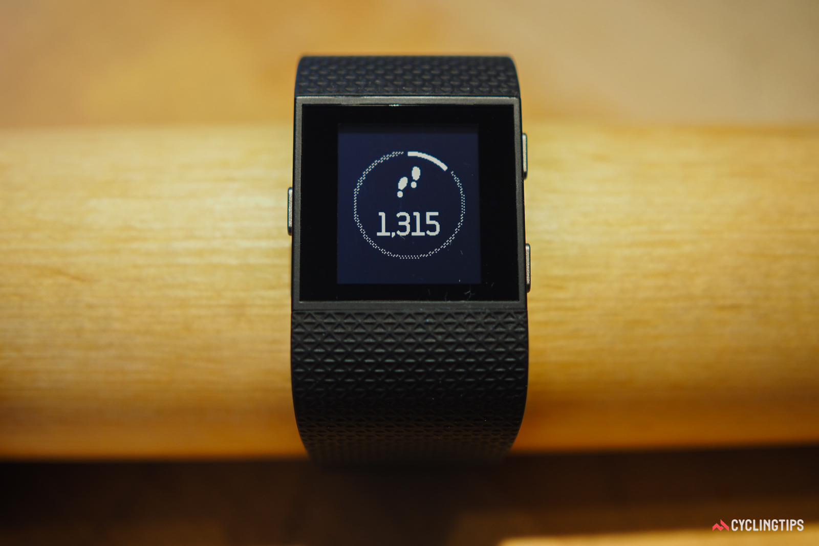 A simple swipe left or right brings up the other main screens on the Fitbit Surge.