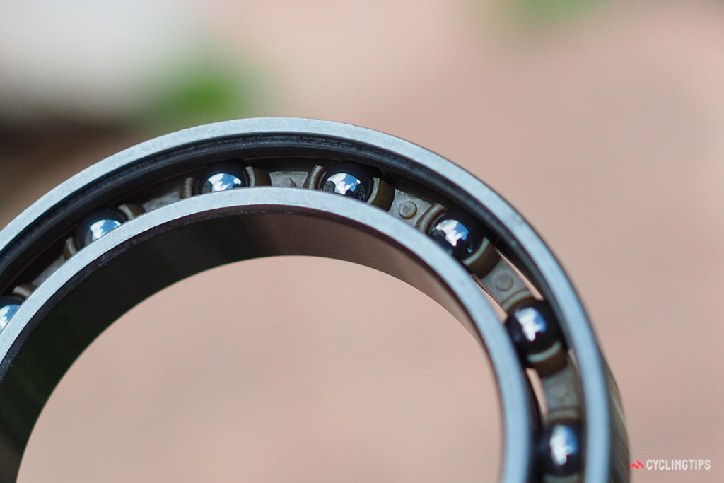 Hybrid ceramic bearings designed for low friction typically have the balls encased in a polymer cage so that they don't rotate against each other.