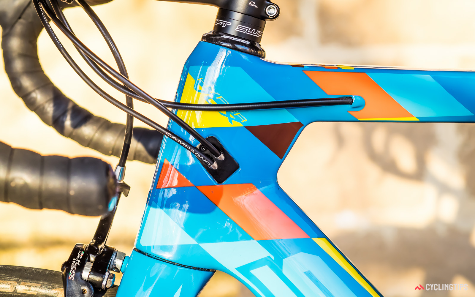 Both derailleur cables enter the down tube on the left hand side of the bike.