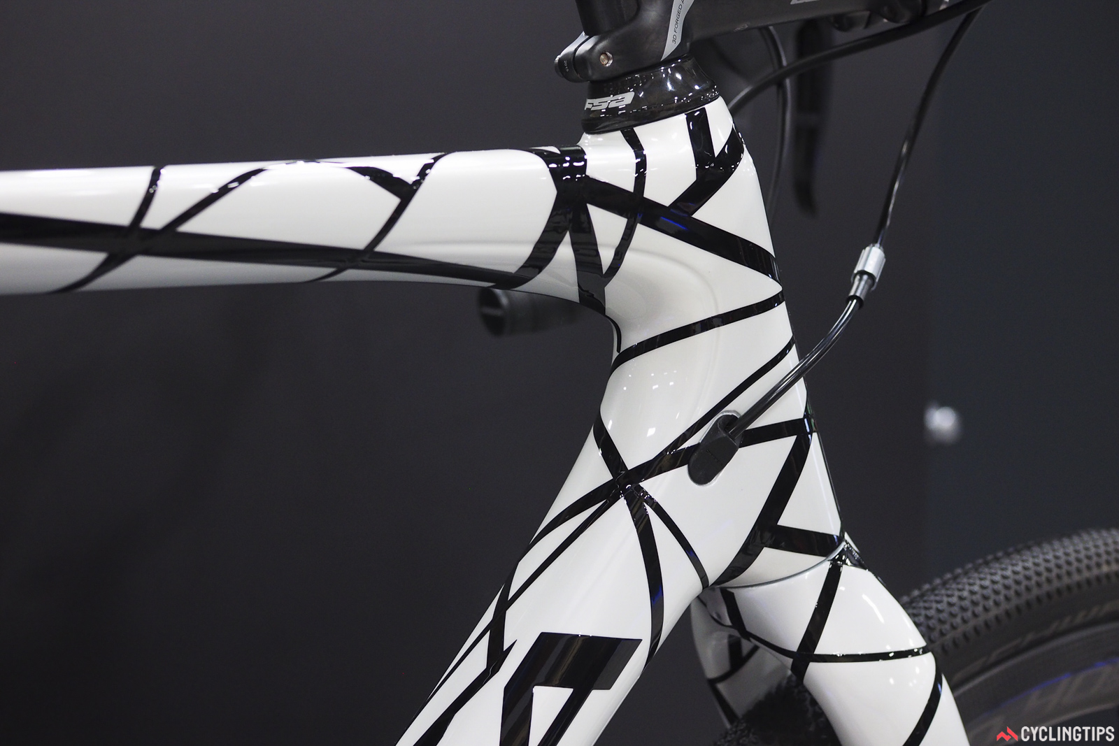 Orbea is actually considering offering this paint job to the public, but it won't be cheap. Each one is truly unique, with every strip of masking tape laid by hand in random orientations. Provided the cost is fairly reasonable, I think the take rate could be quite high.