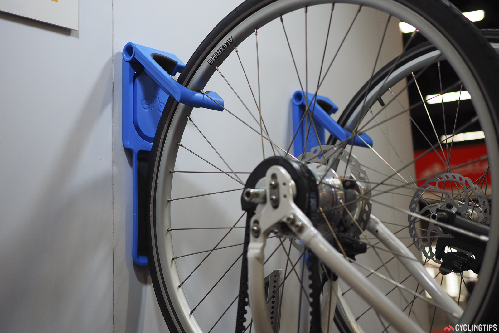 Cycloc's new UK-made Endo wall mount hangs bikes from either wheel, with a hollow hinge big enough for a U-lock. A matching pad down below keeps the other wheel from scuffing the wall. Retail price is US$70.