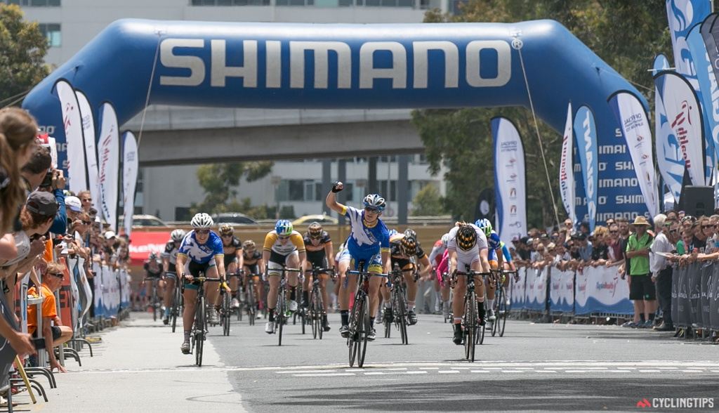 Kimberley Wells sprints to victory in the Shimano Supercrit, ahead of Eileen Roe (Wiggle-Honda) and Chloe Hosking. It is Wells' third criterium victory of the summer, after winning in Noosa and Launceston as well.