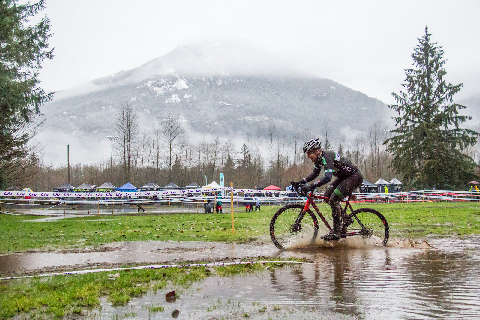 """Jeannine Avelino, Canada. """"A cyclocross racer braves the elements with a beautiful mountain backdrop at the BC Cyclocross Provincials Championships in Squamish, BC this year."""" DSLR. @jeannineavelino"""