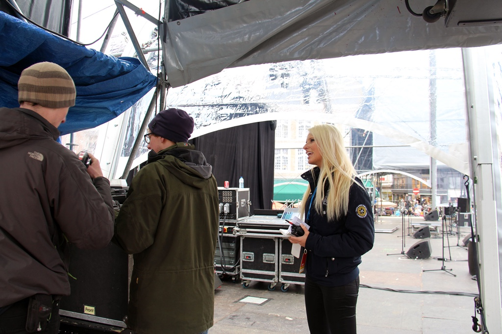 Maja overseeing the setup of the stage in Bruges Grote Markt the day before the Tour of Flanders